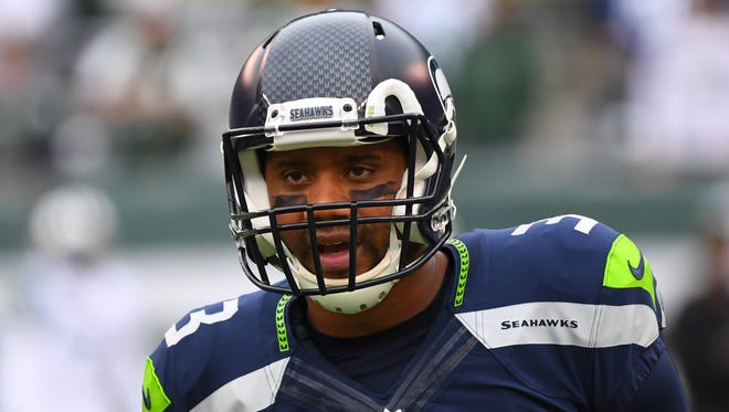 Seattle Seahawks quarterback Russell Wilson (3) warms up before a game against the New York Jets at MetLife Stadium.