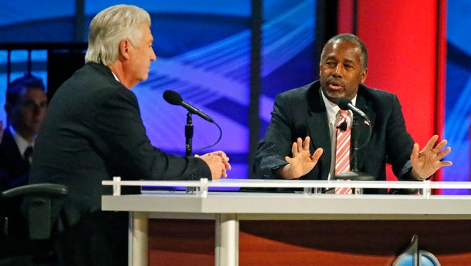 Ben Carson, right, and Jack Graham participate in the North Texas Presidential Forum at Prestonwood Baptist Church in Plano, Texas.