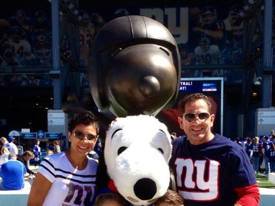My cousin Emma with children Gianna, 6,  Patrick, 7, and husband Pat at a NY Giants game last month.