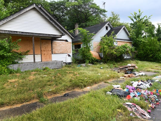 Even though empty homes are boarded up, the lack of residents overseeing the property or neighboring homes doesn't prevent illegal dumping on Central near Joy in west Detroit.