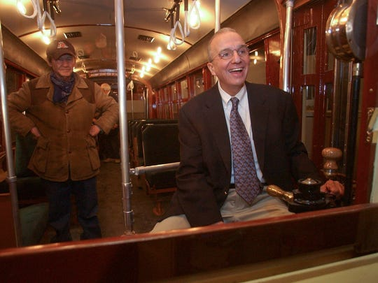 Retired Knoxville News Sentinel Editor Harry Moskos sits at the controls of the restored Streetcar 416 on Jan. 9, 2004, at the East Tennessee History Center. Joe Bell, the former owner of the car, looks on.
