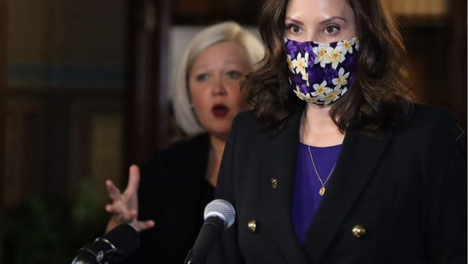 Michigan Gov. Gretchen Whitmer speaks during Wednesday's news conference with an American Sign Language interpreter behind her.