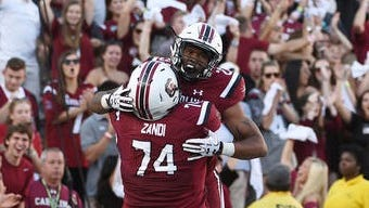 Reynolds alum Rico Dowdle scored his first college touchdown for South Carolina on Saturday in Columbia, S.C.