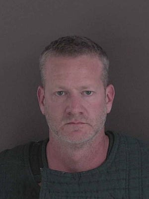 Sean Thomas Banks, 49, was arrested Thursday on theft and misconduct charges.