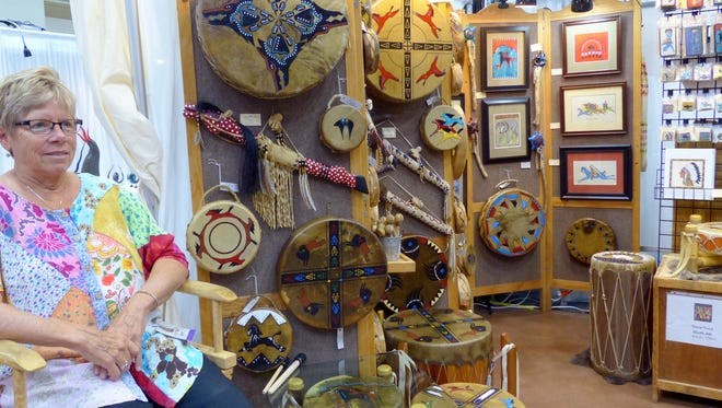 Vicki Trout manned her Black Stone: Native American inspired drums and art booth at the festival.