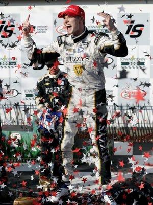 Josef Newgarden celebrates after winning the IndyCar auto race Sunday at Iowa Speedway in Newton, Iowa.