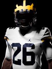 "Michigan's away uniform, courtesy of the Nike ""Jumpman"" brand."