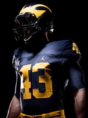 "Michigan's home uniform, courtesy of the Nike ""Jumpman"" brand."