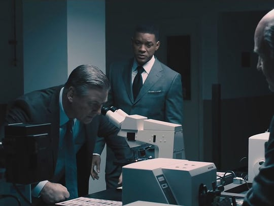 "Alec Baldwin and Will Smith co-star in ""Concussion."""
