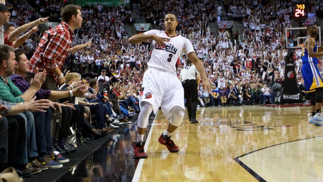 Portland Trail Blazers guard C.J. McCollum reacts after making a 3-point basket against the Golden State Warriors during the second half of Game 4 of an NBA basketball second-round playoff series Monday, May 9, 2016, in Portland, Ore. The Warriors won 132-125.