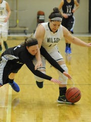 Lee's Elizabeth Snyder and Wilson's Sarah Sondrol battle for a loose ball in the first half of their Conference 36 tournament semifinal Thursday in Fishersville.