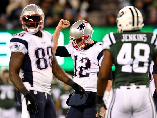 New England Patriots quarterback Tom Brady (12) celebrates after a first down in the second half. The New York Jets lose to the New England Patriots 22-17 at MetLife Stadium on Sunday, November 27, 2016.