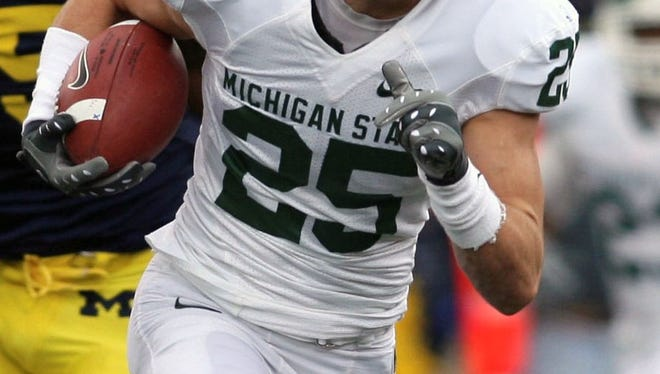Michigan State receiver Blair White (25) outruns Michigan linebacker Obi Ezeh (45) and John Thompson (49) for a touchdown during the first quarter of an NCAA college football game in Ann Arbor, Mich., Saturday, Oct. 25, 2008.