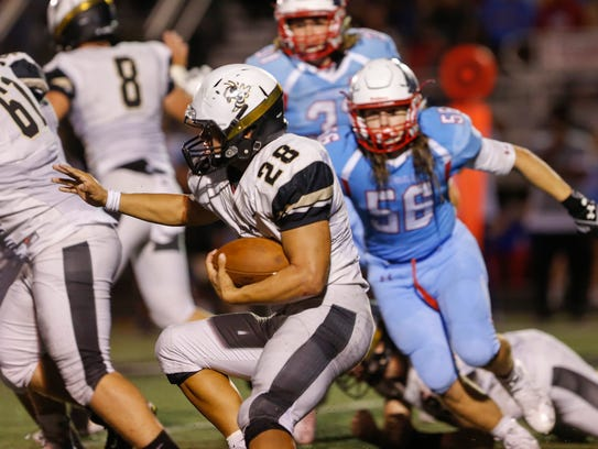 Lebanon's John Berry carries the ball during the team's