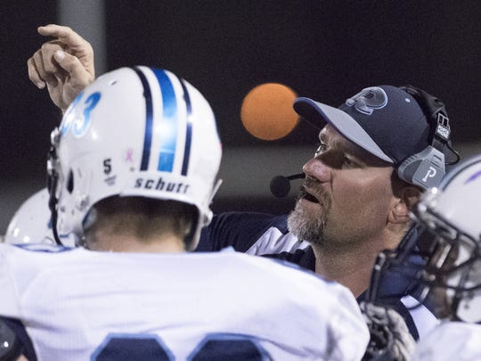 Shaun Ball is the head football coach at Redwood High School.