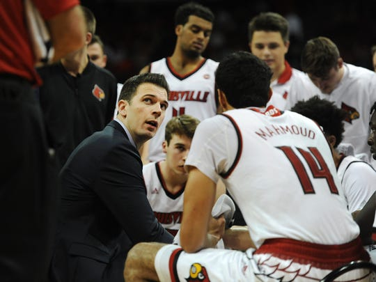 Louisville interim coach David Padgett speaks with players during an exhibition against KWC.