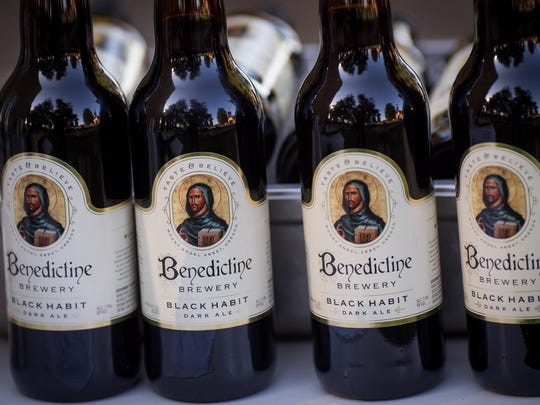 Sample Benedictine Brewery pale ale at the Saint Benedict