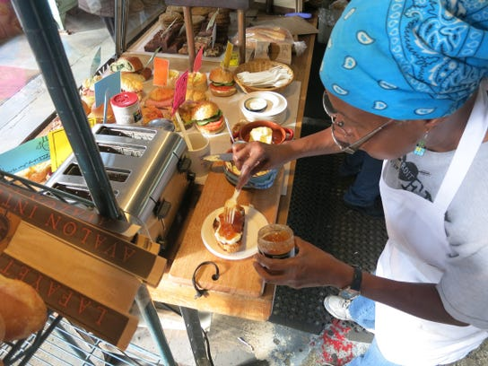 Avalon International Breads employee Bevon Brooks spreads