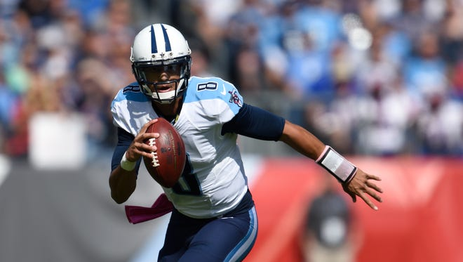 Titans quarterback Marcus Mariota (8) running out of the pocket in the first half at Nissan Stadium on Sunday Oct. 11, 2015, in Nashville, Tenn.