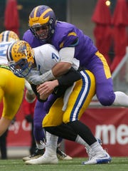 New Berlin Eisenhower defensive lineman Mark Shields sacks Rice Lake quarterback Peyton Buckley in the second quarter during the WIAA Division 3 state football championship game at Camp Randall Stadium.