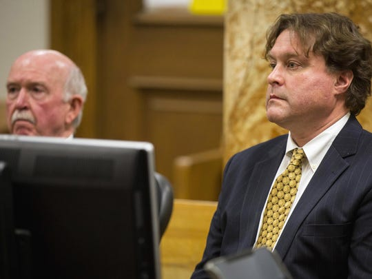 Texas businessman Robert Rhodes (right) faces a judge with his attorney, Joseph Cahill, in Polk County District Court in Des Moines, Iowa, in January 2017. After Rhodes collected a Wisconsin Lottery jackpot that had been rigged by his friend, he used the windfall for an investment scheme that produced another wave of undeserved government money, court records show.