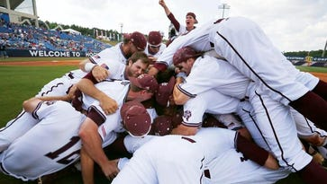 Texas A&M's players celebrate their win over Florida after the Southeastern Conference NCAA college baseball championship game at the Hoover Met, Sunday, May 29, 2016, in Hoover, Ala.