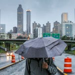 Jason Connor walks on Freedom Parkway on Thursday, Dec. 24, 2015, in downtown Atlanta. The Atlanta Convention and Visitors Bureau has said that companies are reconsidering holding their conventions in the city because of the possibility Georgia Gov. Nathan Deal will sign a controversial religious-freedom bill.