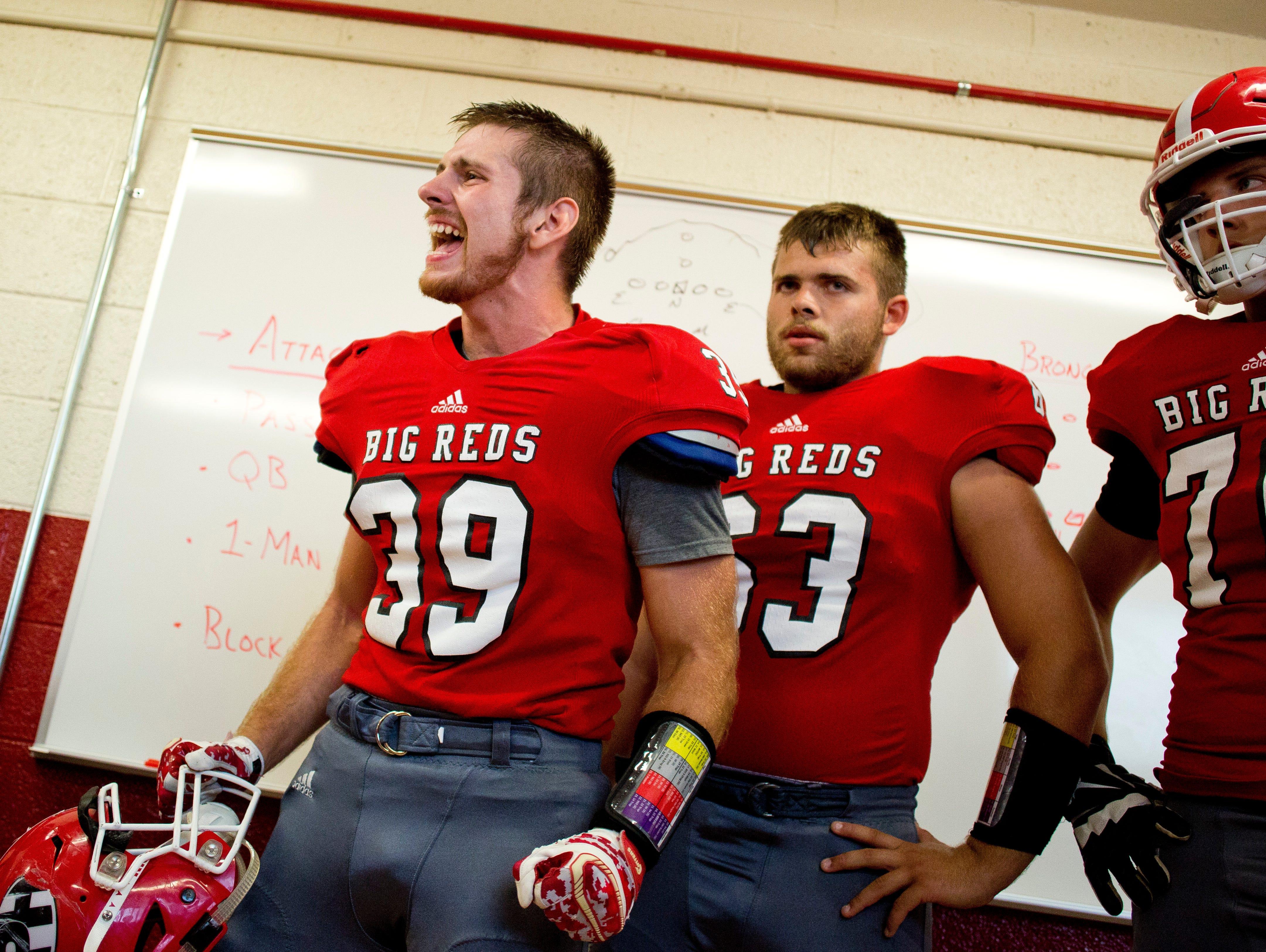Port Huron senior Devon Lynch hypes up his teammates in the locker room during a football game Friday, September 25, 2015 at Memorial Stadium in Port Huron.