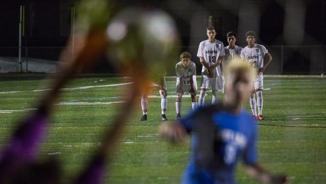 Gulf Coast players watch as their keeper blocks a shot during the Class 4A regional final shootout at Gulf Coast High School on Wednesday.