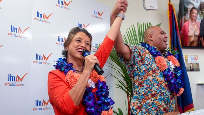 Gubernatorial candidate Lou Leon Guerrrero, left, and running mate Josh Tenorio, raise their clasped hands into the air in a show of unity to a cheering crowd of supporters during the official opening their campaign headquarters at the Ada Cliffline Office Center Building C in Hagåtña on Wednesday, Oct. 4, 2017.
