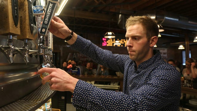 Cody Edwards of Des Moines pours a glass of his Watershed Cold Brew coffee on Saturday, March 12, 2016, at the Iowa Taproom in Des Moines. The coffee, which has no alcohol, is the first nitro coffee from Iowa.