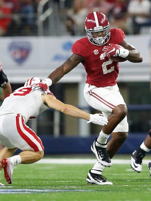 Sep 5, 2015; Arlington, TX, USA; Alabama Crimson Tide running back Derrick Henry (2) runs with the ball for a third quarter touchdown against Wisconsin Badgers safety Leo Musso (19) at AT&T Stadium.