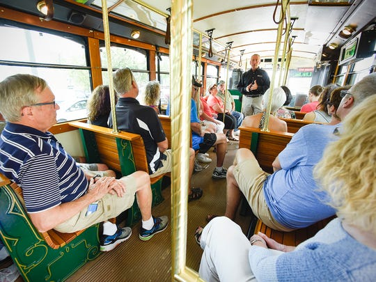 St. Cloud Mayor Dave Kleis talks about the history of the city Friday, July 21, during a 90-minute trolley tour around town. More tours are planned for the coming months.