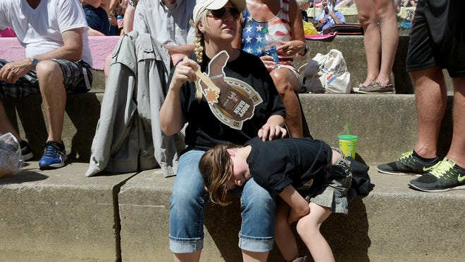 Rachel Clemons of Knoxville fans her daughter Austynn,6, during the hot weather at CMA Music Festival on Friday, June 10, 2016.