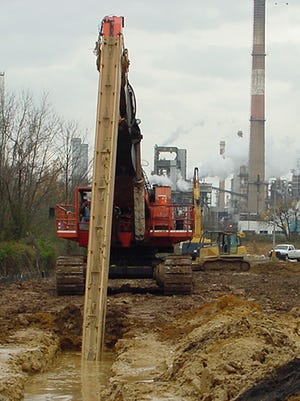 An EPA contractor prepares a deep trench in 2007 for a 5,900-foot, bathtub-like pollution containment wall that now surrounds 35 acres of the former Metachem Products plant north of the Delaware City Refinery.