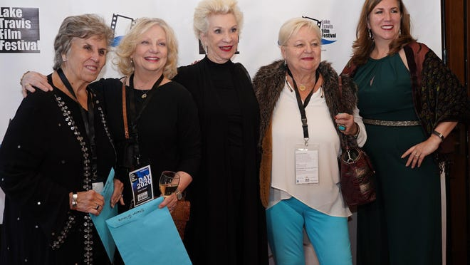 From left, Barbara Beebe, Sharon Gilmore, Gretchen Nearburg, Sharon Rogers and Lakeway Mayor Sandy Cox pose for a picture on the first night of the Lake Travis Film Festival in February. The festival has committed to holding in-person showings for its second annual event in June 2021.
