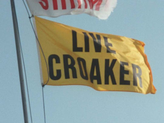 Most bait shops show the availability of live croaker by flying a yellow flag.