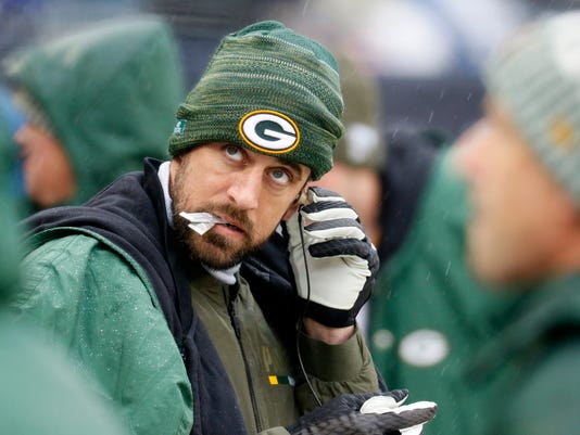Green Bay Packers quarterback Aaron Rodgers looks at the scoreboard Sunday, Nov. 12, 2017, during an NFL football game against the Chicago Bears in Chicago. (Daniel White/Daily Herald via AP)