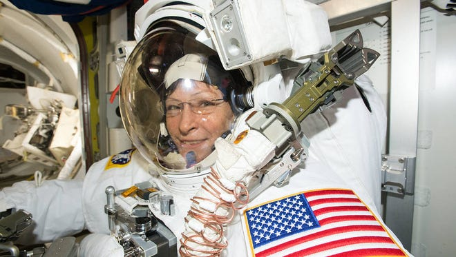 In March 2017, NASA astronaut Peggy Whitson suited up in the U.S. Quest airlock getting ready for a spacewalk outside the International Space Station.