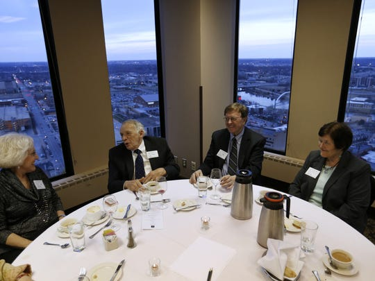 Jan Hill (from left) listens as husband and Prairie Club Member Dr. Bill Cotton talks with fellow club member Arden Borgen and his wife, Margaret, Friday, March 27, 2015, during the private club's meeting at the Des Moines Club in downtown Des Moines.