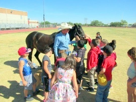 Belle is a perfect ambassador to show students why horses continue to be important to ranching. Matt Midgett provides the translation.