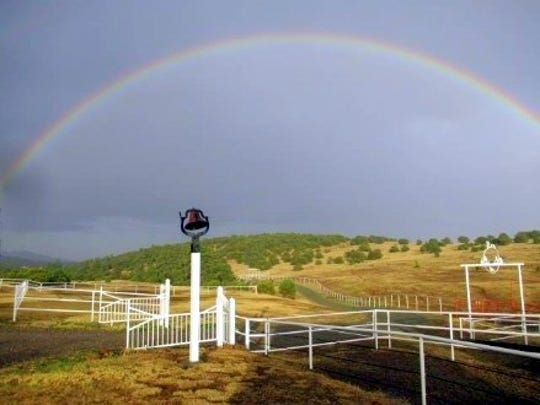 The sky still was dark and ominous, but a rainbow changed the mood at Matthew Midgett's ranch.