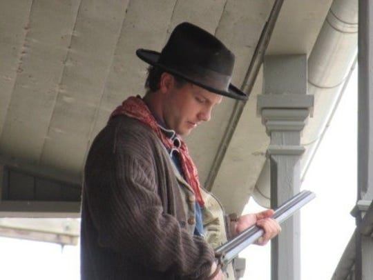 Billy the Kid reenactor prepares to shoot his second