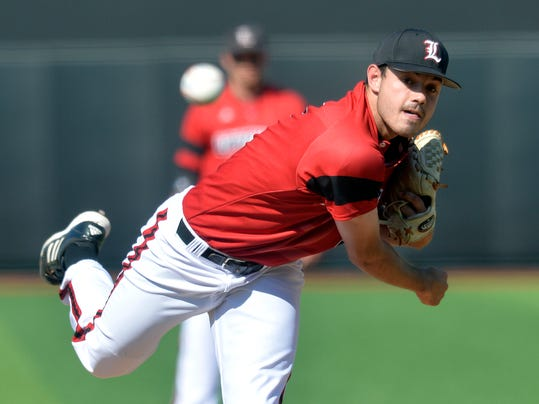 Louisville's Anthony Kidston pitches Kansas during an NCAA college baseball regional tournament game in Louisville, Ky., Saturday, May 31, 2014. (AP Photo/Timothy D. Easley)