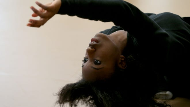 Aryanna Anderson rehearses her dance solo during an International Baccalaureate dance program at Eastridge High School.