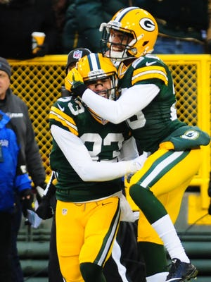 Green Bay Packers defensive back Micah Hyde, left, is congratulated by cornerback Casey Hayward after scoring a touchdown on a punt return against the Detroit Lions at Lambeau Field.