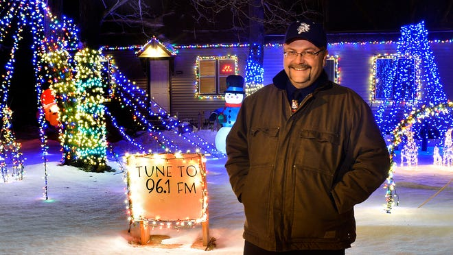 Dave King sets up an elaborate Christmas light display at his home at 1512 Washington Memorial Drive that incorporates up to 10,000 lights choreographed to music that can be heard by turning to an FM radio broadcast. He was photographed Nov. 25.