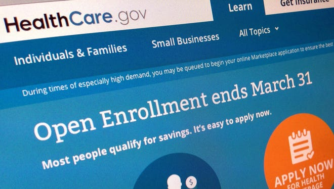 Photo shows part of the website for HealthCare.gov as photographed in Washington. The new health care law helps some people, hurts others and confuses almost everyone.