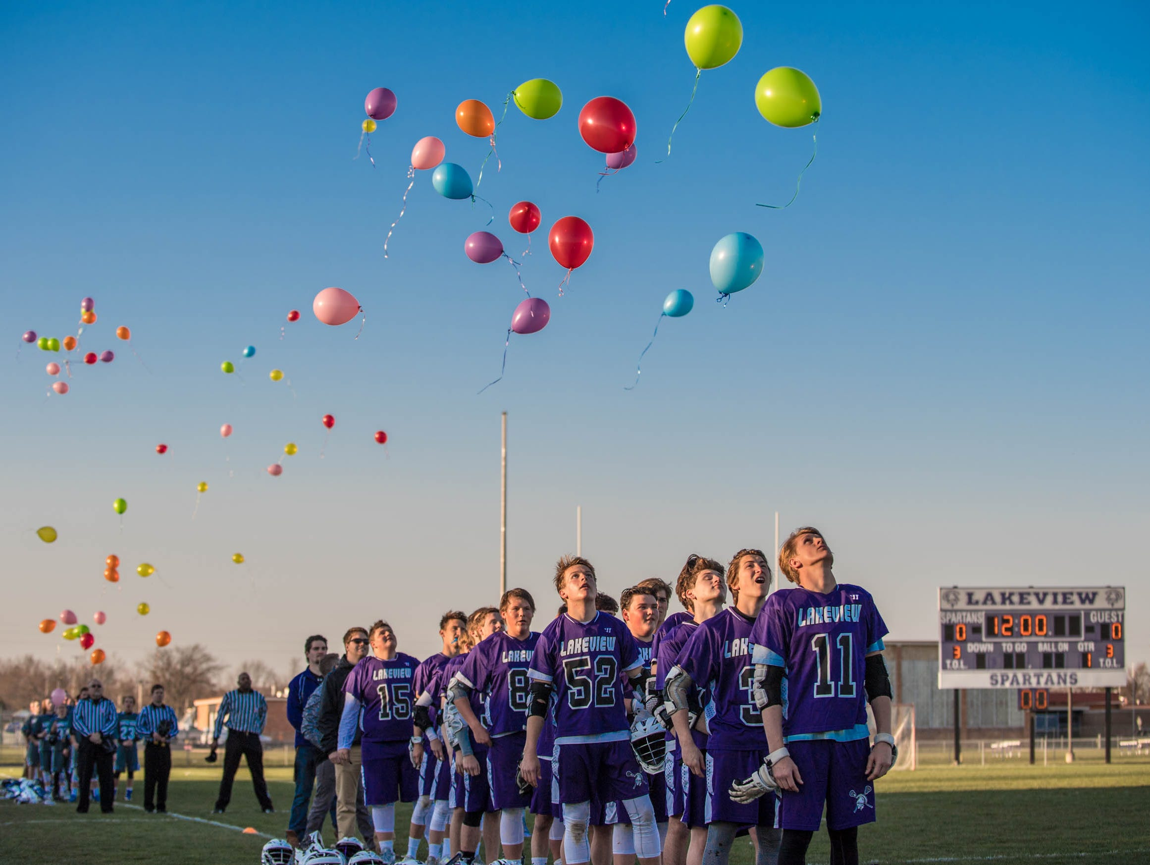 Balloons released before the start of the varsity game.