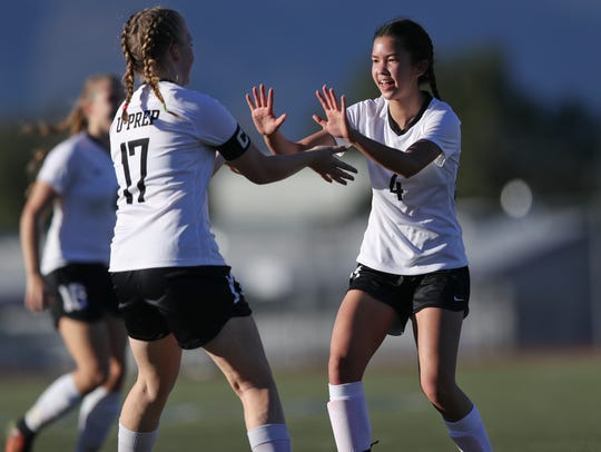 U-Prep's Savannah Leak, right, and Emma Nichols celebrate